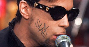"** FILE ** Prince, with the word ""Slave"" written across his face is shown performing in New York's Rockefeller Plaza in this July 9, 1996 file photo. Recently a number of superstar acts are rejecting traditional multiyear album contracts with major record labels in favor of deals that offer bigger dollars and more creative freedom. (AP Photo/Richard Drew/FILE)"