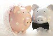 Pink and blue pig ornaments dressed like bride and groom